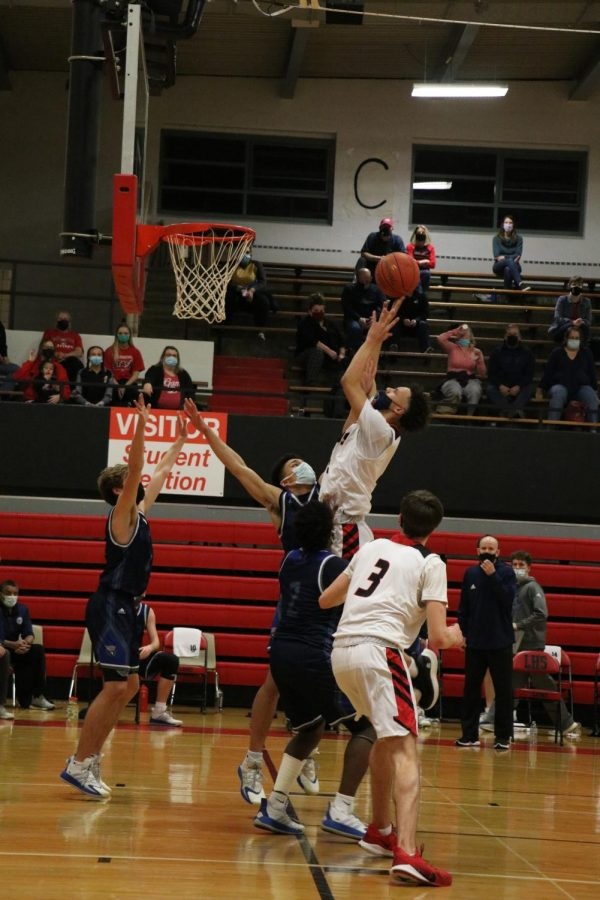 Senior Zeke Mayo goes for a layup during the substate championship game on Friday, March 5th.