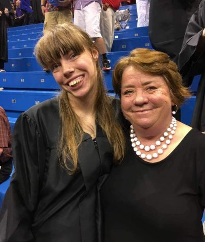 Lawrence High para educator poses for a photo with LHS graduate Cheyenne Graham at a graduation ceremony.