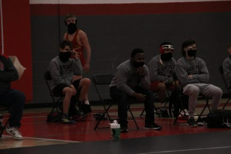 Members of the wrestling team watch intensely during a meet at Lawrence High versus Washburn Rural on January 27.