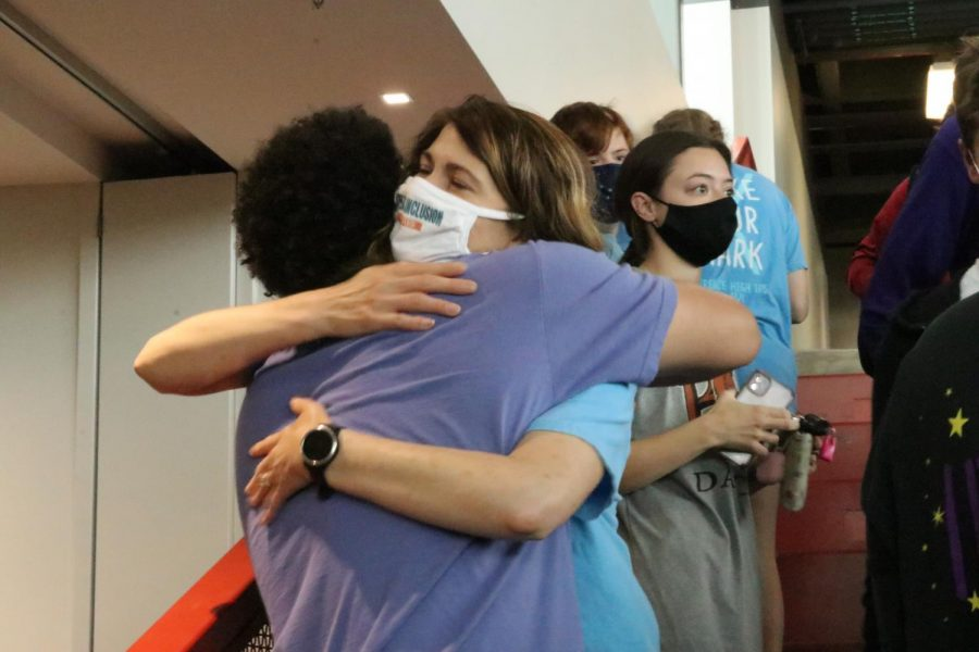 Teacher Susie Micka is embraced by students after being surprised as a Bobs Award winner on Tuesday.