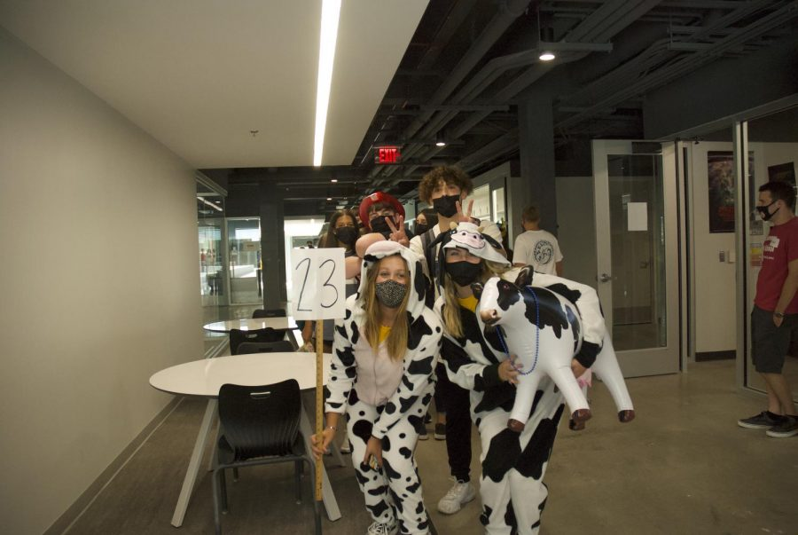 Cow-themed group 23 poses for a picture.