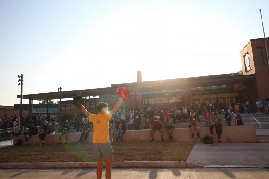 Waving pom-poms, senior Nick Cordova excites the crowd.
