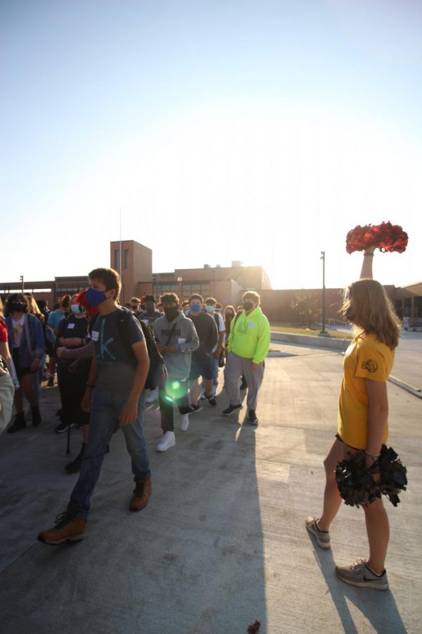 A Link Crew member cheers students.