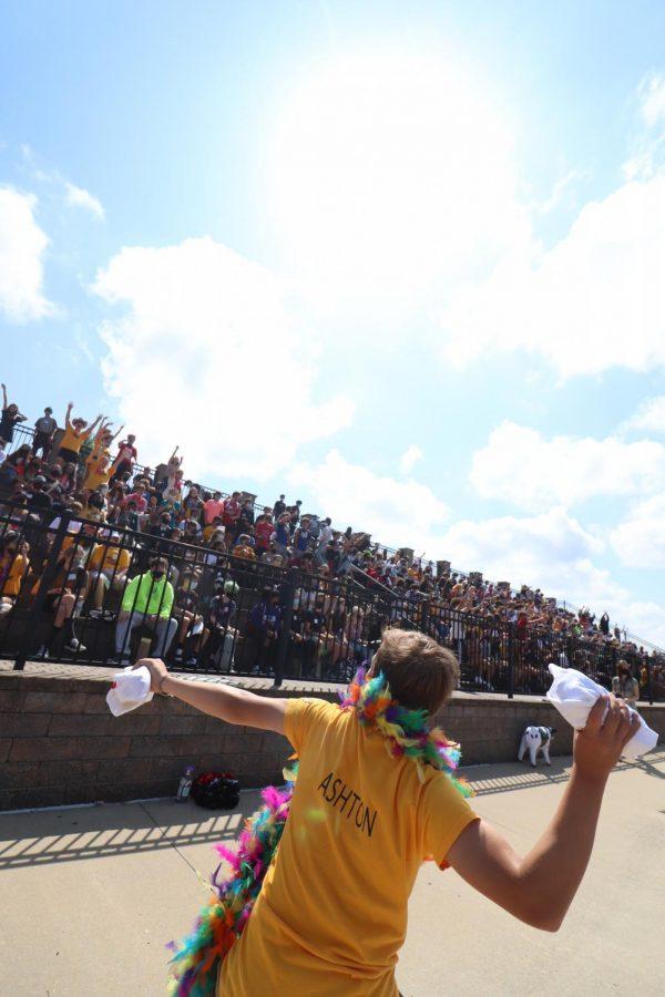 Senior Ashton Rapp throws t-shirts into the crowd.