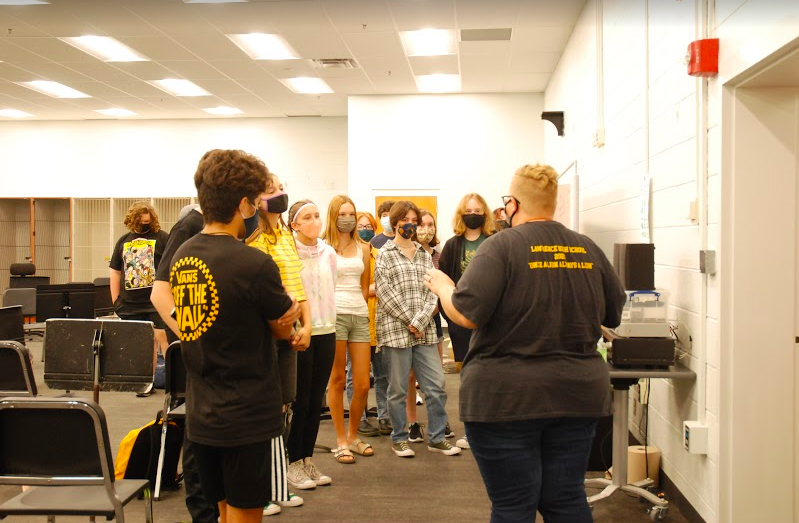 Orchestra teacher Mariah Barnett shows students around the new school building during the first day of school Aug 19.
