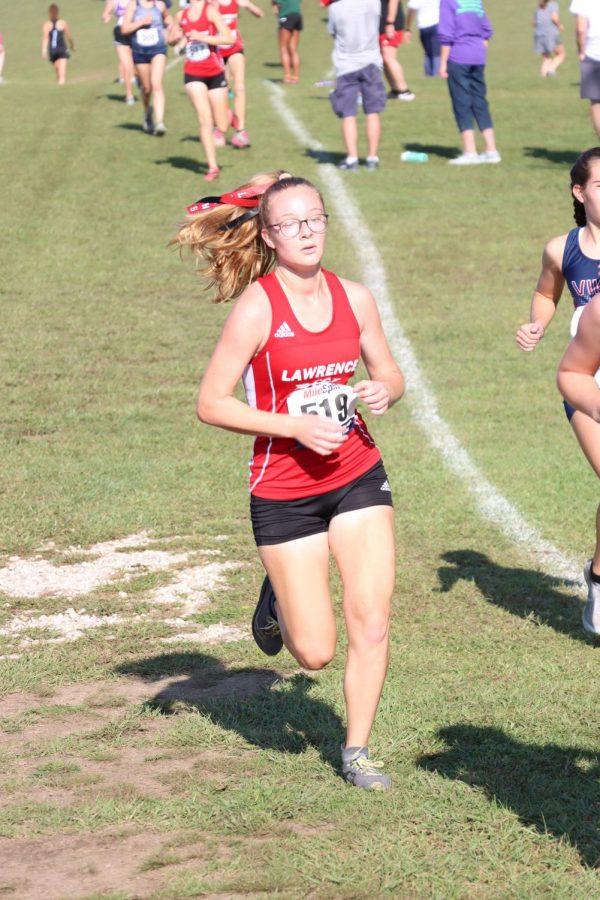 Senior Grace Harader-Ellett runs at the cross country race in Baldwin on Sept. 18.