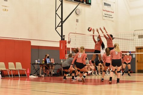 The LHS volleyball team scrimmages during the fall sports jamboree Aug. 25.
