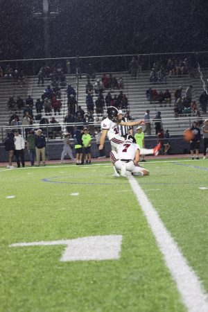 Senior kicker Grant Glasgow attempts a kick during a game against Mill Valley.
