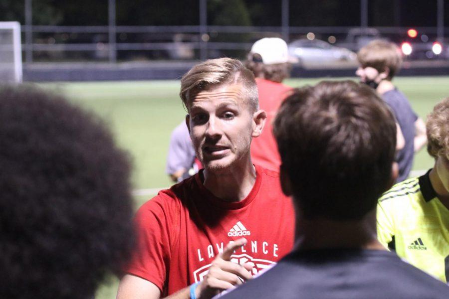 Boys soccer head coach Brandon Daley talks to his team during a home game against Olathe North on Sep 2.