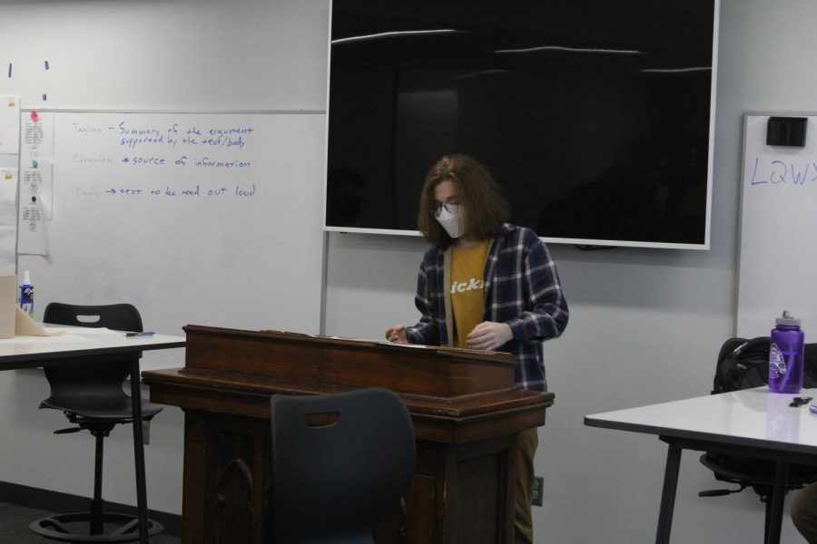 Senior Eliot Manning gives a speech during a practice debate.